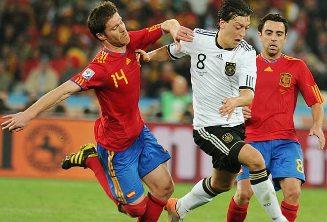 Xabi Alonso (left) and Xavi (right) were part of winning teams at Euro 2008 and 2012 and World Cup 2010.