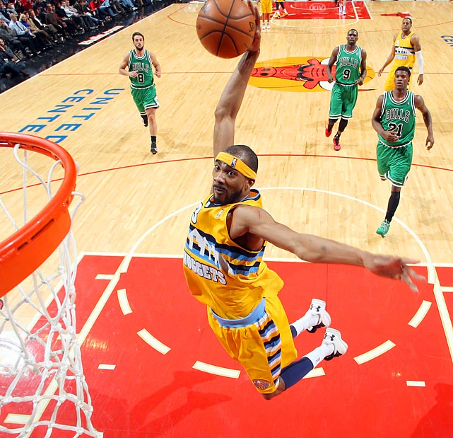 The Nuggets' Corey Brewer reaches back for a huge dunk in the open court during Denver's 119-118 win over the Bulls.