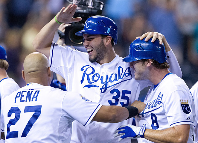 Kansas City needs Eric Hosmer (center) and Mike Moustakas (right) to start fulfilling some of their sizable promise this year.