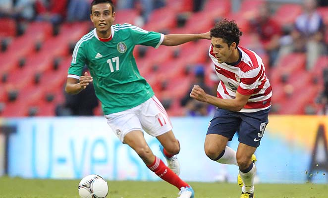 Herculez Gomez (right) and the U.S. won at Estadio Azteca for the first time in an August friendly.