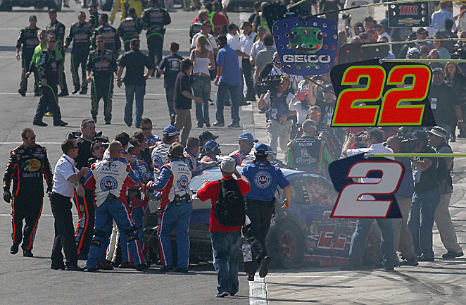 Joey Logano and Tony Stewart drew a crowd as they exchanged post-race pleasantries at Fontana.