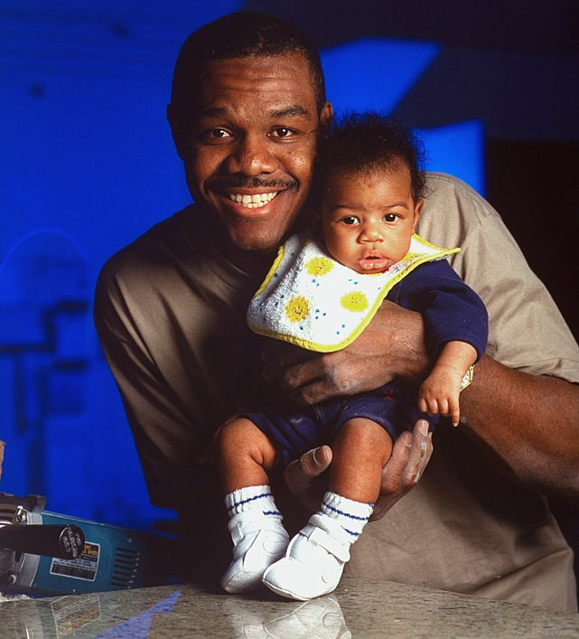 Cunningham holds his two-month-old son, Randall Jr., in his hometown of Las Vegas.
