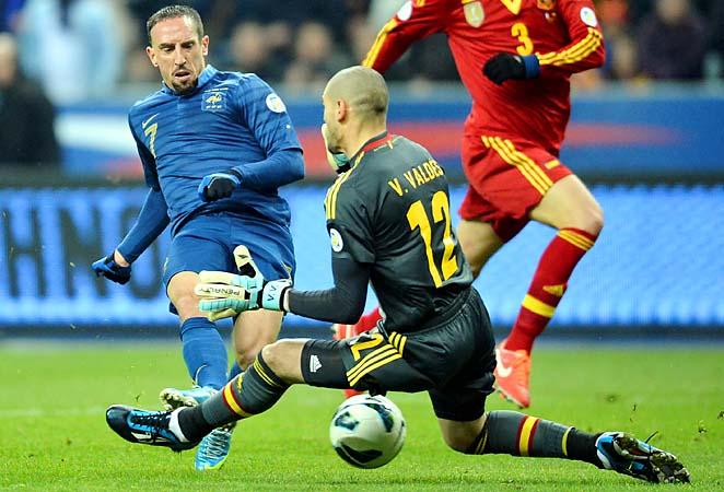 Spanish goalkeeper Victor Valdes stops a Franck Ribery shot in a 2-1 win over France.