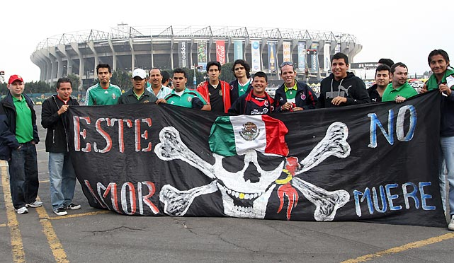 We can't read Spanish, but we're willing to guess that these Mexican fans outside Estadio Azteca in Mexico City are turning their attention and fervor on the Pittsburgh Pirates after Mexico's national team ground out a dispiriting goalless stalemate with the USA in a CONCACAF World Cup Qualifying Final Round match. Mexico's third straight draw left it fifth in its six-team group and made the Pirates look like a more attractive rooting interest.