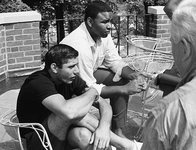 Joe Namath sits with Winston Hill during the Jets summer training at Peekskill Military Academy in Peekskill, NY.