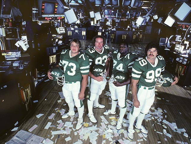 Joe Klecko, Marty Lyons, Abdul Salaam and Mark Gastineau pose of the floor of the New York Stock Exchange.