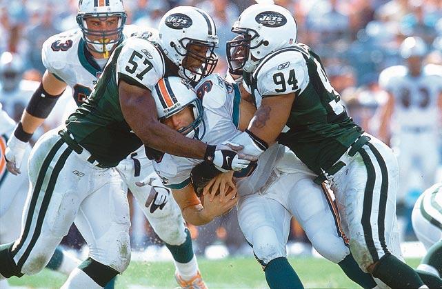 Mo Lewis and John Abraham sack Dolphins quarterback Jay Fiedler.