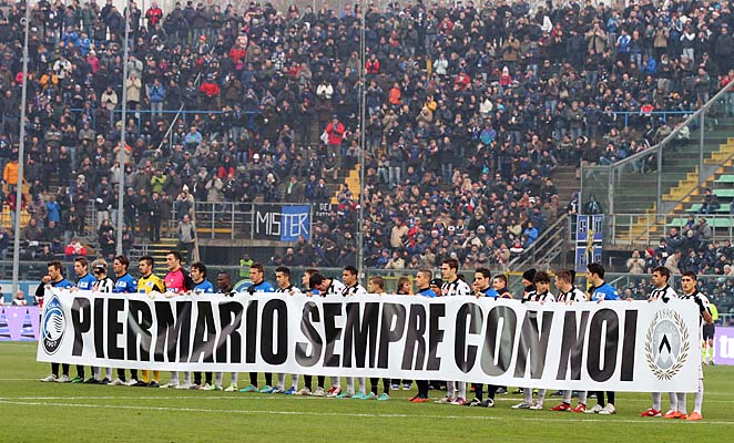Udinese and Atalanta team display a banner to remember Livorno's Piermario Morosini prior to a Serie A match in December.