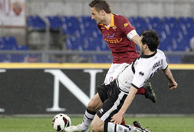 Francesco Totti is fouled by Parma midfielder Marco Parolo during a Serie A match earlier this month.
