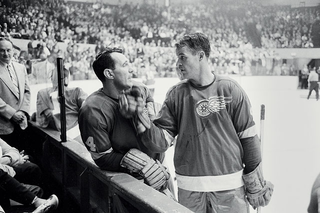 Howe and Bill Gadsby talk on the ice during a break in the action of a game against the Canadiens in October 1963. Howe spent 25 seasons with the Red Wings and still holds eight franchise records, including games played (1,687), goals (786) and points (1,809).