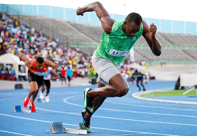 Usain Bolt, pictured here in Kingston, will go after the record on a specially-built track on Copacabana beach.