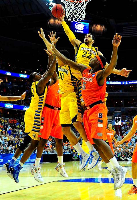 <bold>Marquette's Trent Lockett (22) skies for a layup attempt against the Orange defense. </bold> <bold>Defeated Montana 81-34</bold> <bold>Defeated California 66-60</bold> <bold>Defeated Indiana 61-50</bold> <bold>Defeated Marquette 55-39</bold> <bold>Next: vs. Michigan</bold>