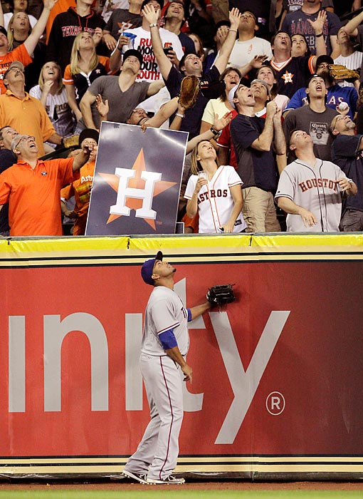 Nelson Cruz watches the ball leave the park on a Rick Ankiel three-run homer in the sixth inning on Opening Day at Minute Maid Park. Ankiel's home run was the finishing blow of the Astros' 8-2 win.