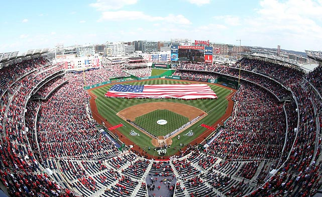 The Washington Nationals unfurl the American flag before the singing of the national anthem on Opening Day.