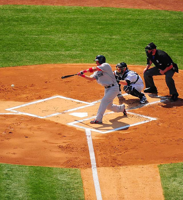 Red Sox outfielder Shane Victorino shoots a single through the middle for his first hit of the 2013 season.