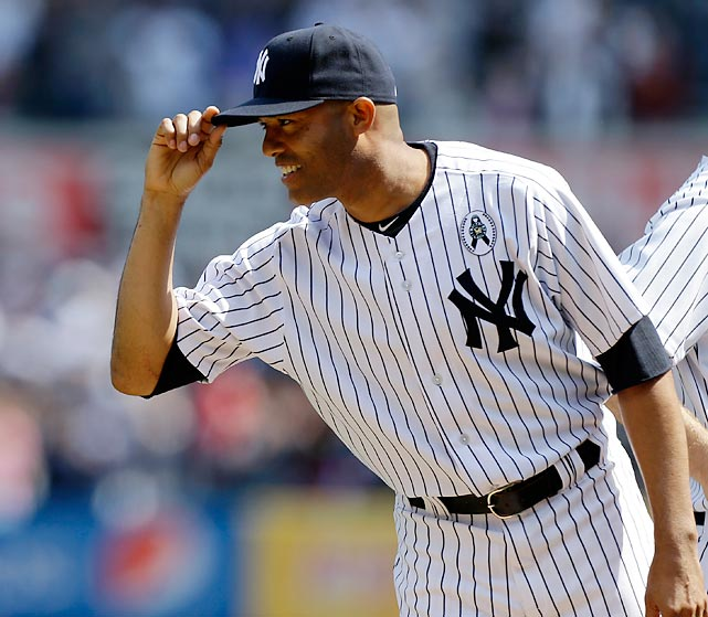 New York Yankees relief pitcher Mariano Rivera tips his cap to Red Sox players on Opening Day. Rivera missed most of the 2012 season after injuring himself during batting practice.