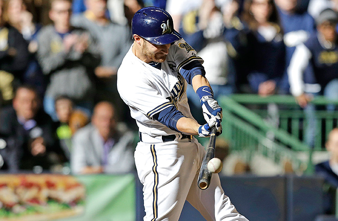Jonathan Lucroy hit a walkoff sacrifice fly in extra innings to secure the Brewers' win over the Rockies.