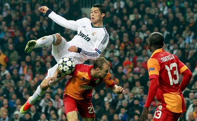 Cristiano Ronaldo crashes into Semih Kaya during the first half of their Champions League match.