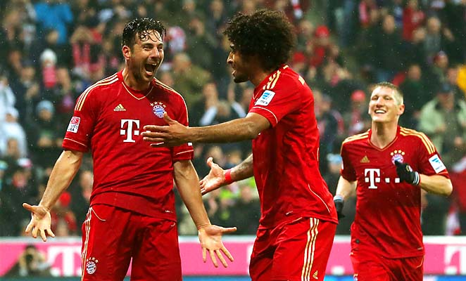 Claudio Pizarro, Dante and Bastian Schweinsteiger celebrate a Bayern goal in a Bundesliga match last week.