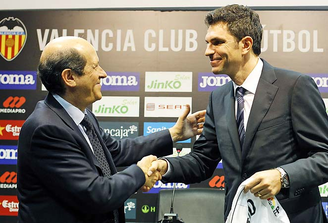 Manuel Llorente (left) greets coach Mauricio Pellegrino upon Pellegrino's hiring in June.