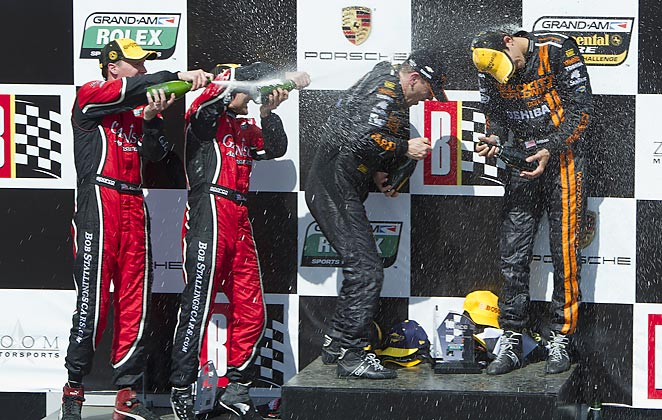 Max Angelelli and Jordan Taylor get a Champagne shower following their victory.
