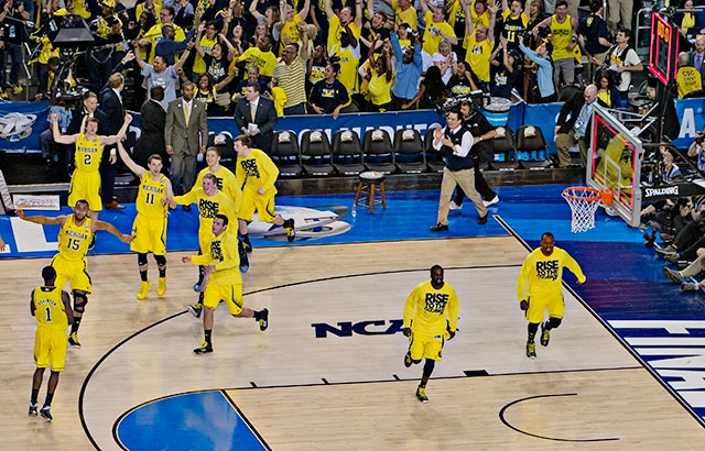 Turnovers and missed free throws almost doomed the Wolverines, but they pulled out the victory and celebrated afterwards.