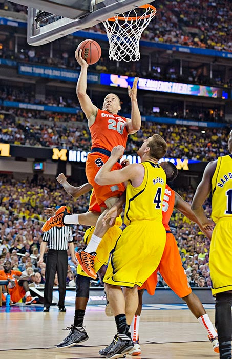 "Triche, shooting here against Mitch McGary, blamed himself for driving the ball recklessly into the lane when Syracuse trailed 58-56. ""I was just trying to make a play for the team,'' he said. ""I probably should have made a better decision, probably should have pulled up for the jump shot. ... I did see him [Jordan Morgan], but I figured, I was already in the air jumping.''"