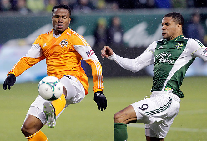 Ryan Johnson, right, scored two goals to give Portland their first win under head coach Caleb Porter.