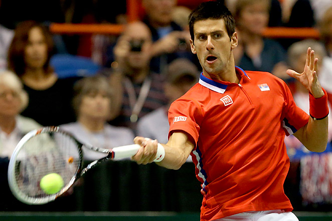 World No. 1 Novak Djokovic overcame a twisted ankle to defeat Sam Querrey and the U.S. in the Davis Cup quarterfinals.