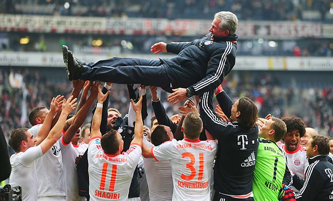 Bayern Munich players raise manager Jupp Heynckes in celebration following their title-clinching win.