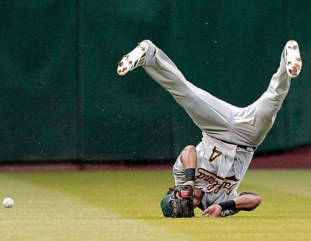 A's outfielder Coco Crisp dives but comes up a bit short on a line drive from former teammate Chris Carter.
