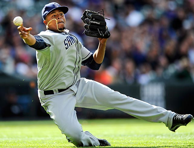 Edinson Volquez makes an acrobatic play from the mound to throw out Reid Brignac during the sixth inning of a game between the Padres and the Rockies.