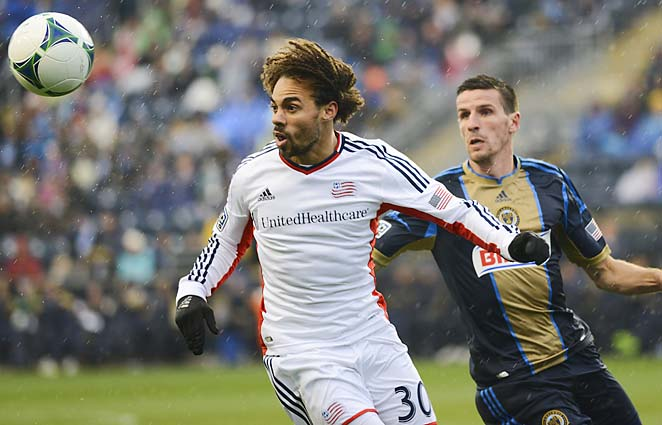 Kevin Alston (left) vies for the ball with the Union's Sebastien Le Toux.
