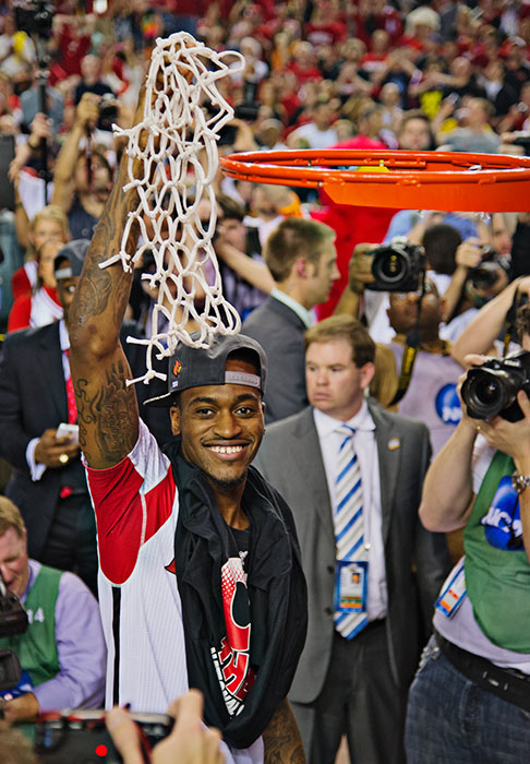 Kevin Ware, who suffered a snapped tibia earlier in the tournament, put his crutches aside to help cut down the nets with his teammates.