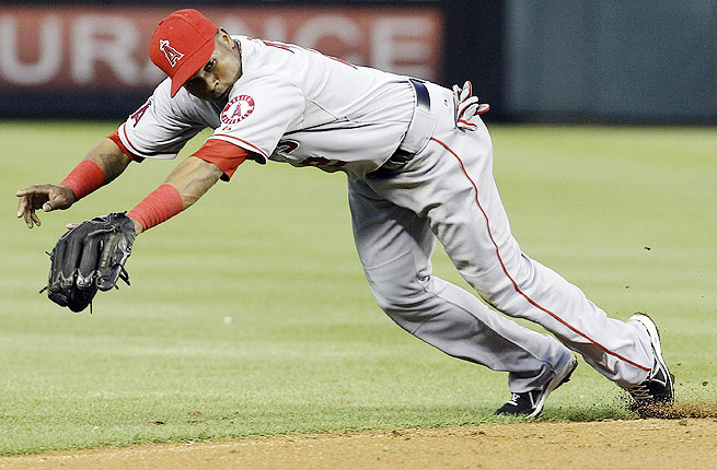 Erick Aybar tried to stay in the game after jamming his left foot on first base, but eventually had to come out.