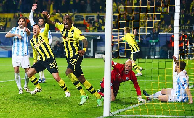 Borussia Dortmund celebrates Felipe Santana's (center) deciding goal to beat Malaga.