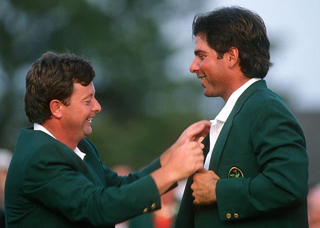 Ian Woosnam helps Fred Couples into his green jacket in '92. For the win, Couples earned $270,000.