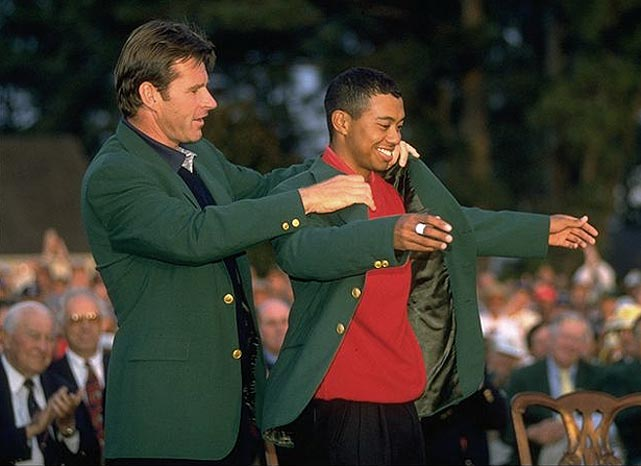Nick Faldo put the green jacket on Tiger Woods after his 12-stroke victory.