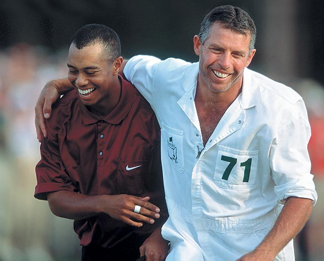 "Woods and caddie Steve Williams celebrated Tiger's victory at the 2001 Masters, his fourth-straight major victory, now known as the ""Tiger Slam."""