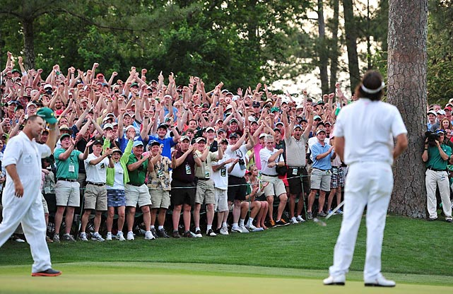 Augusta National patrons celebrated as Bubba Watson sank a one-foot putt on the first playoff hole to win the 2012 Masters.