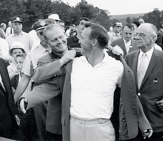 Jack Nicklaus helps Arnold Palmer into his fourth and final green jacket.