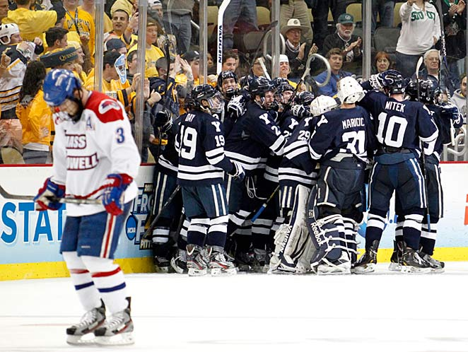 The jubilant Yale Bulldogs mob their captain, Andrew Miller, after he scored his overtime game-winner.