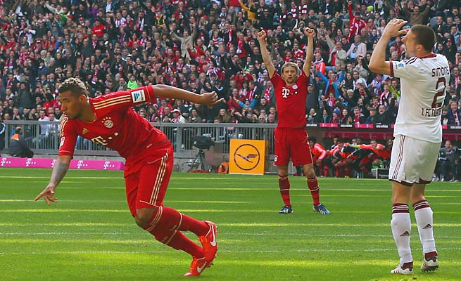 Bayern Munich's Jerome Boateng (left) celebrates one of his club's four goals on Saturday.