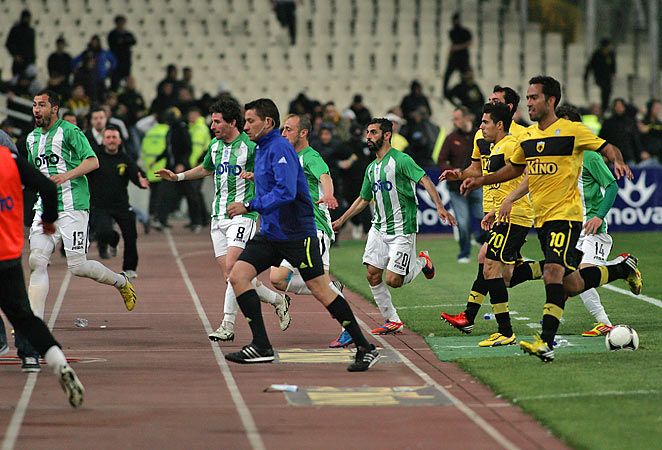 AEK Athens and Panathanaikos players were chased off the field by rioters on Sunday.