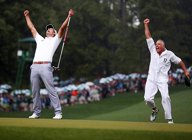 Adam Scott celebrates his birdie putt with caddie Steve Williams after clinching the Masters on the second playoff hole. Scott became the first Australian to win a Masters title.