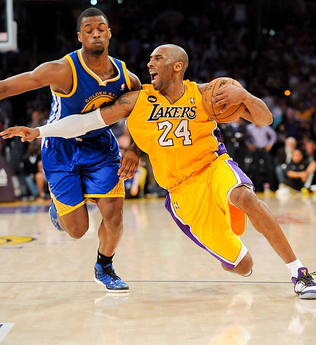 Kobe Bryant suffers a season-ending Achilles injury while driving against Harrison Barnes #40 of the Golden State Warriors. Bryant is expected to be out 6-9 months.