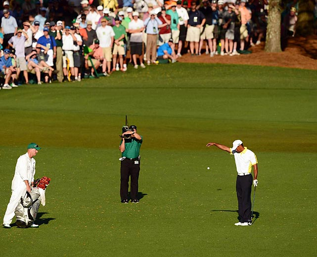 Tiger Woods takes his controversial drop during Friday's round at The Masters. Woods was eventually penalized two strokes for the drop after it was deemed he improved his lie.