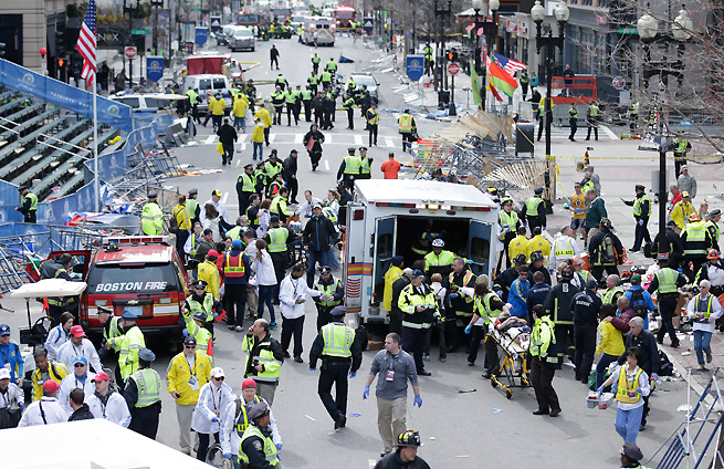 Emergency crews flooded the scene helping those injured after two explosions went off near the Boston Marathon finish line.