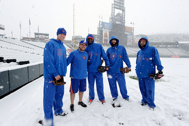 Mets pitchers stand for a photo in the snow before a scheduled game against the Colorado Rockies at Coors Field in Denver on April 15. The game was canceled.