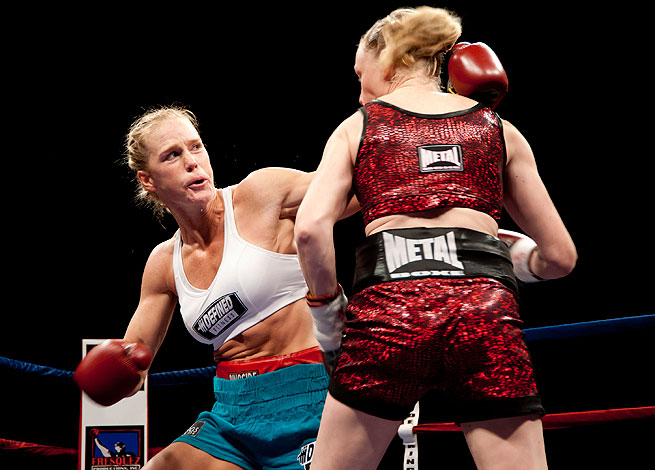 Holly Holm (left) has compiled a 32-2-3 record as a professional boxer.